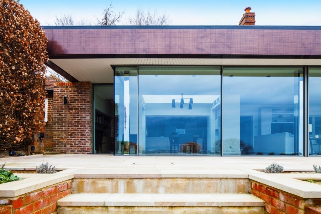 contemporary single storey glazed extension to traditional building