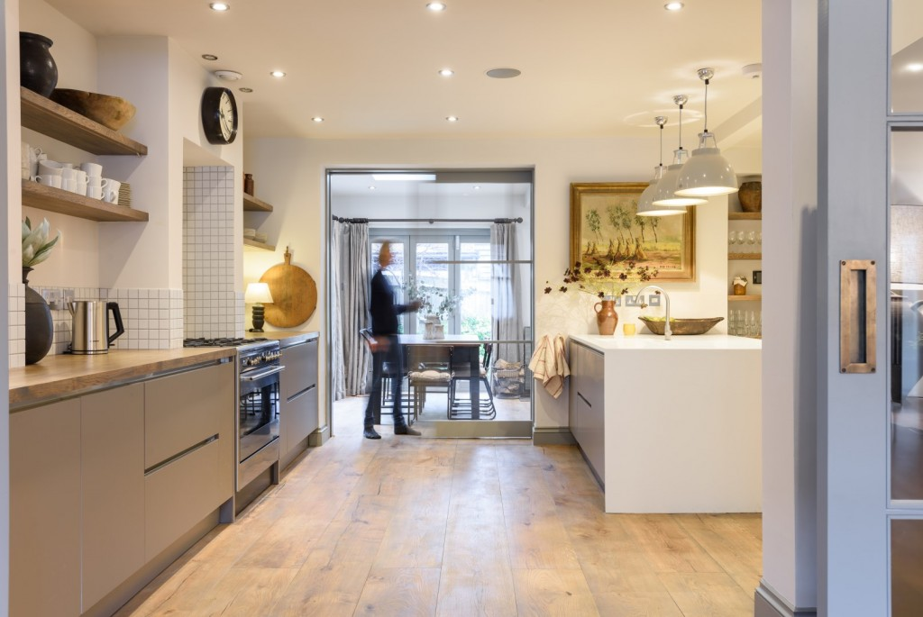 modern open plan kitchen restored floor boards