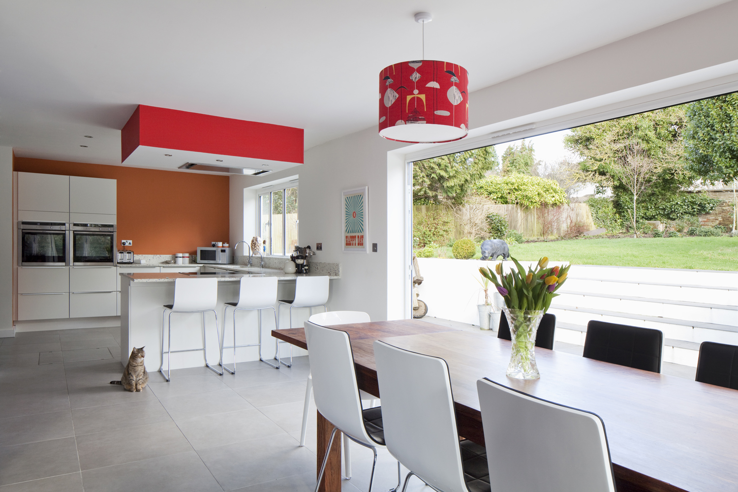 modern white kitchen with pops of colour