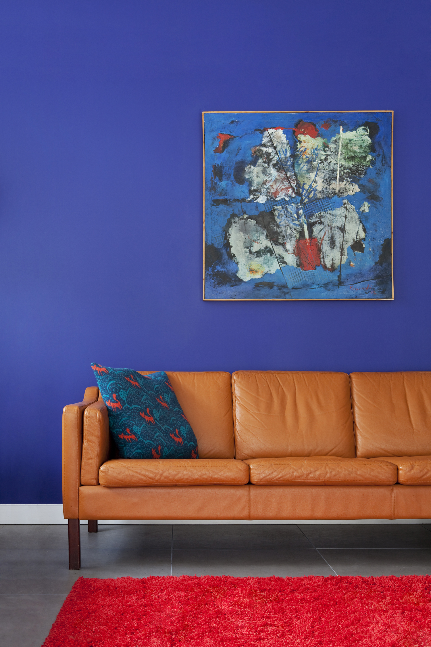 orange leather sofa purple wall