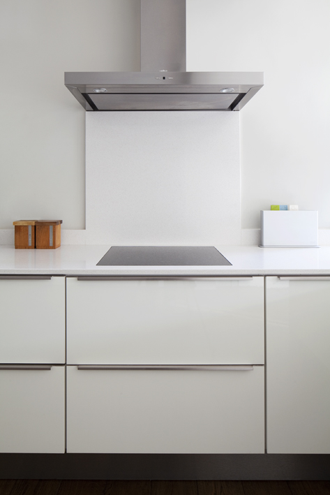 contemporary white bespoke kitchen with discreet pull handles