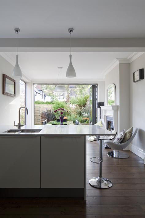 open plan kitchen diner to colourful landscaped garden