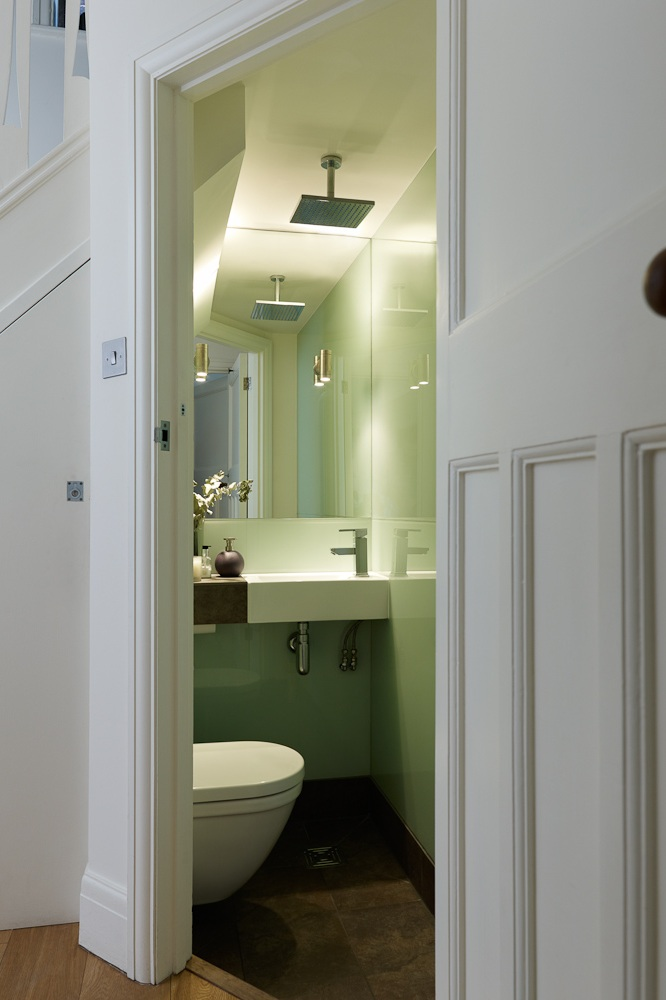 clever and contemporary wet room under staircase