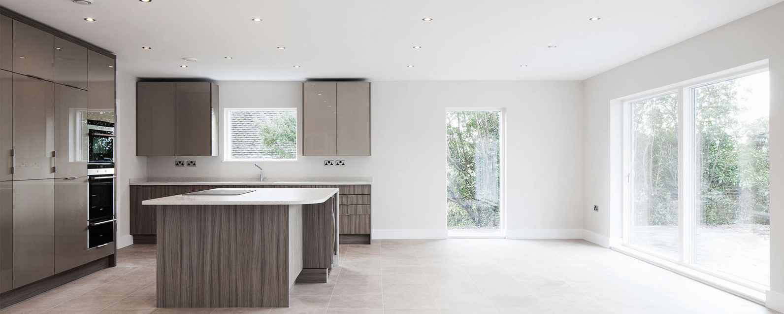 contemporary and minimalist kitchen with expansive sliding doors to the exterior