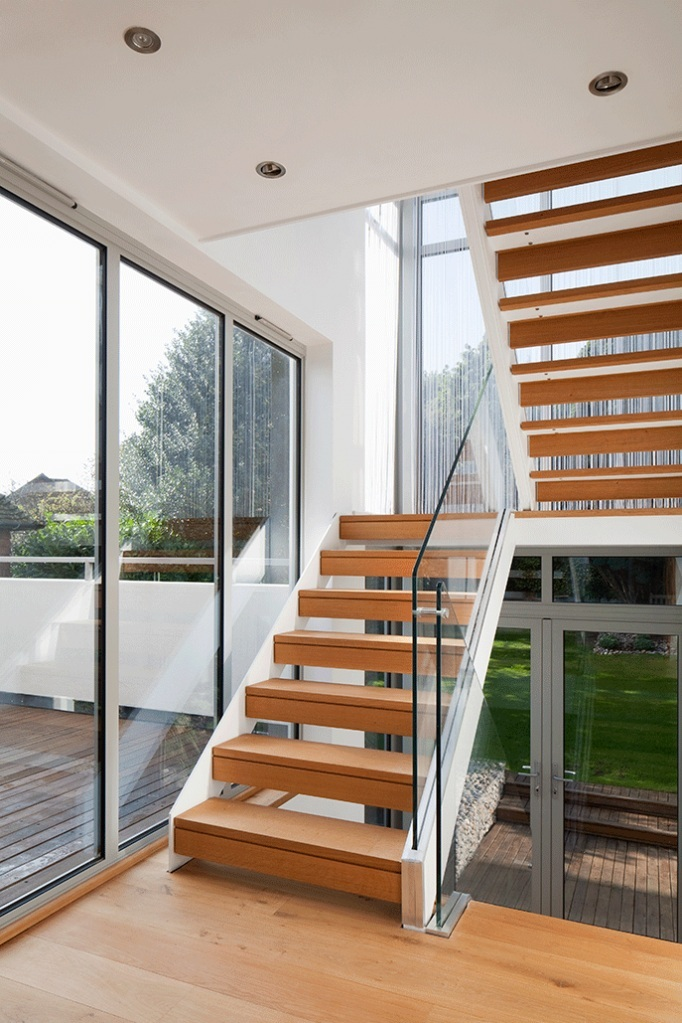 open tread natural wood stair with glass balustrade