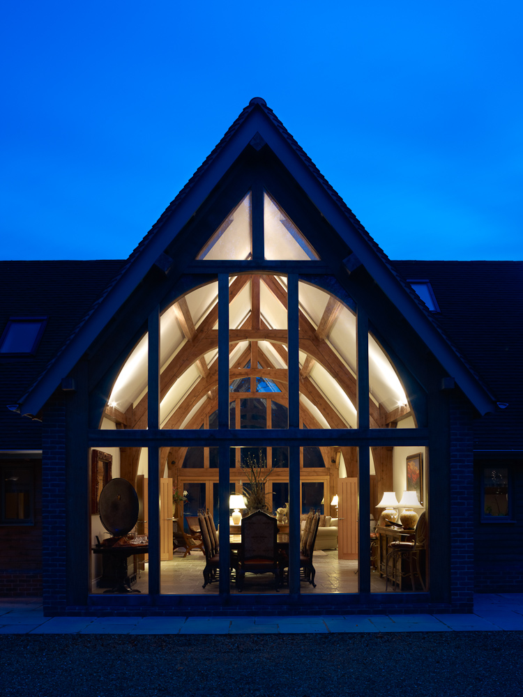dusk view of the timber frame home's great room