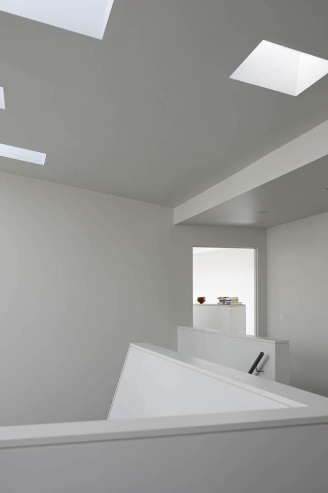 sculptural stair gallery area with interesting skylights