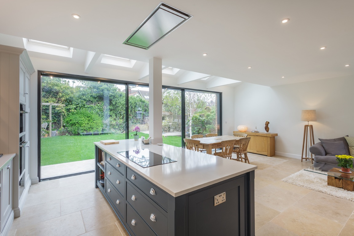bright kitchen diner extension with bespoke joinery and expansive bifold doors