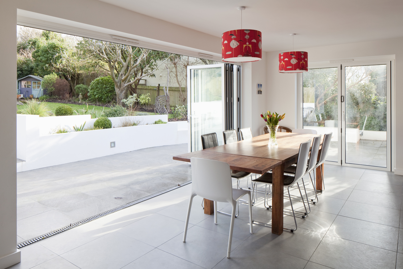dining room with lots of light sliding doors open