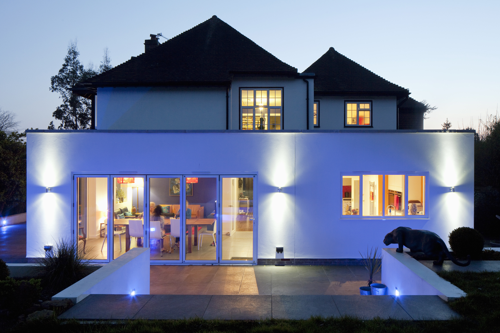 rear view of single storey extension at night