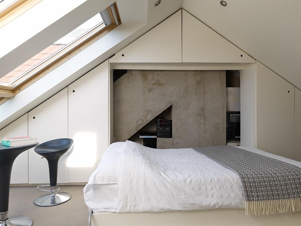 loft conversion creates fourth bedroom skylights bring in light