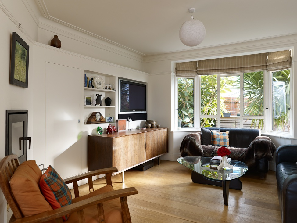 open plan living area with lots of light and greenery outside