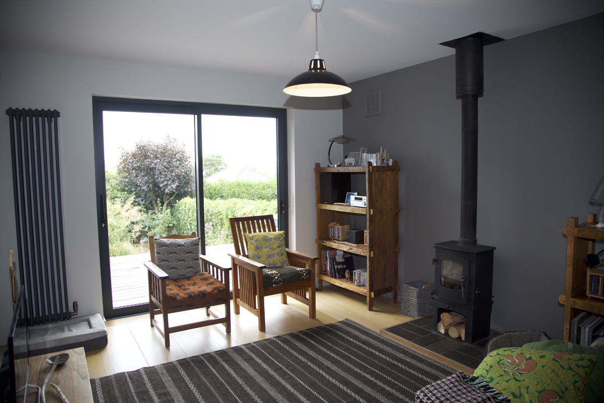 cosy living room with wood stove and views to garden