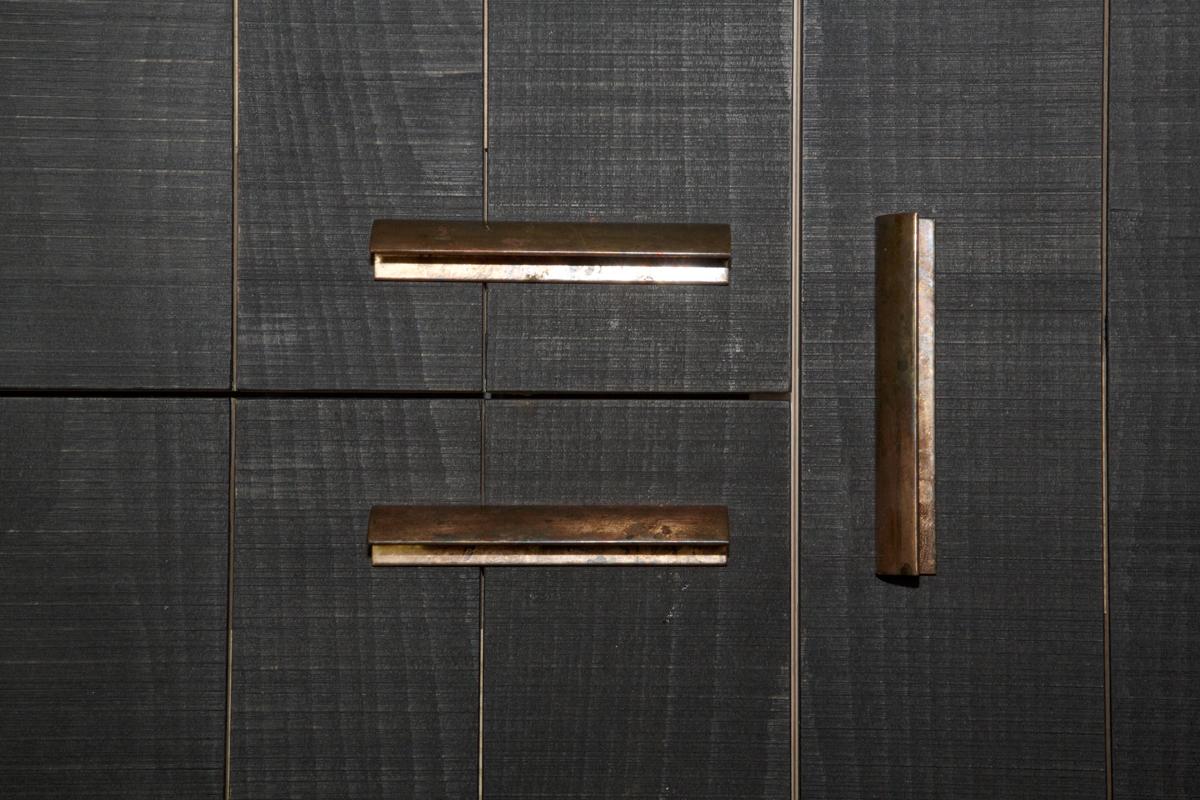 dark wood with copper recessed finger pulls