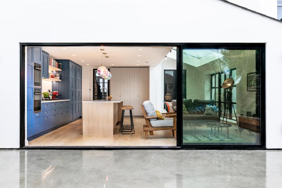 large sliding doors connection living area to porcelain terrace