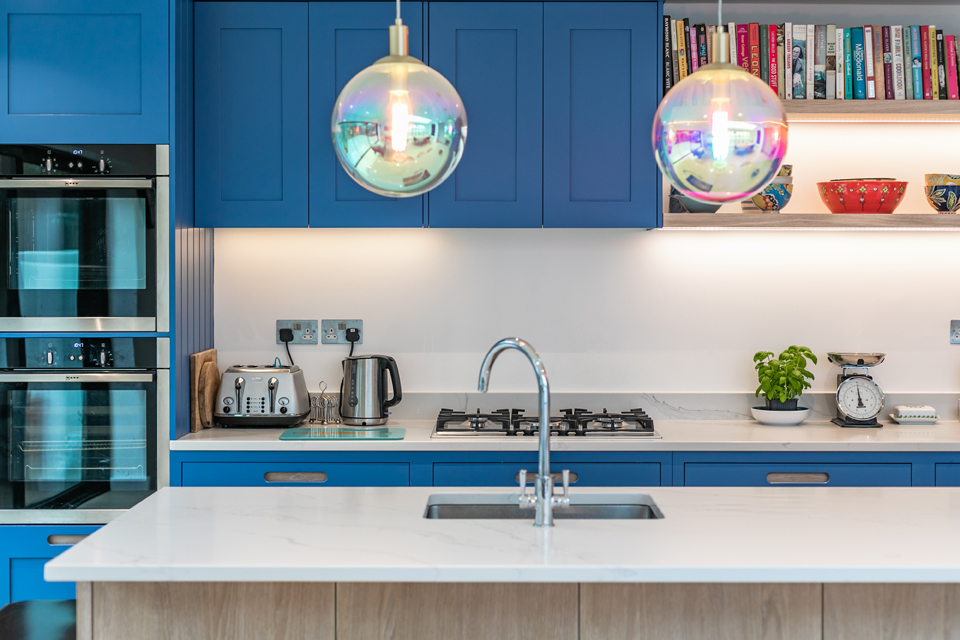 light island countertop blue kitchen and colourful cookbooks