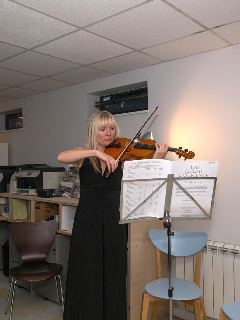archangels celebrates five years anita plays the violin