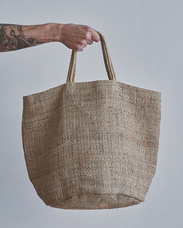 "Gifts that give back 🙌 To buy click on link in bio and find these beautiful bags in our store- - Large hand woven jute bag, ideal as your go to bag. - - ""Out with the leather in with the Jute"" - Maison Bengal was set-up in 2004 in order to help fight poverty in Bangladesh, working particularly with mothers and young women. They work very closely with three fair trade organisations in country, each one best placed to identify the most marginalised communities in their area and provide training in handicraft production. Maison Bengal works with each group separately to utilise their locally grown natural materials and develop their renowned traditional skills. This combined with a contemporary designs has allowed them to produce these stunning hand woven products. Maison Bengal now works with over two thousand women throughout Bangladesh, happily able to work in their home environment enabling them to care for as well as financially support their families. - - - #bags #handmadegifts #fairtrade #handwoven #vegan #vegangifts #xmasgifts #buylessbuybetter #evogifts #sociallyresponsible #makingadifference #saynotoleather #maisonbengal #formenandwomen"