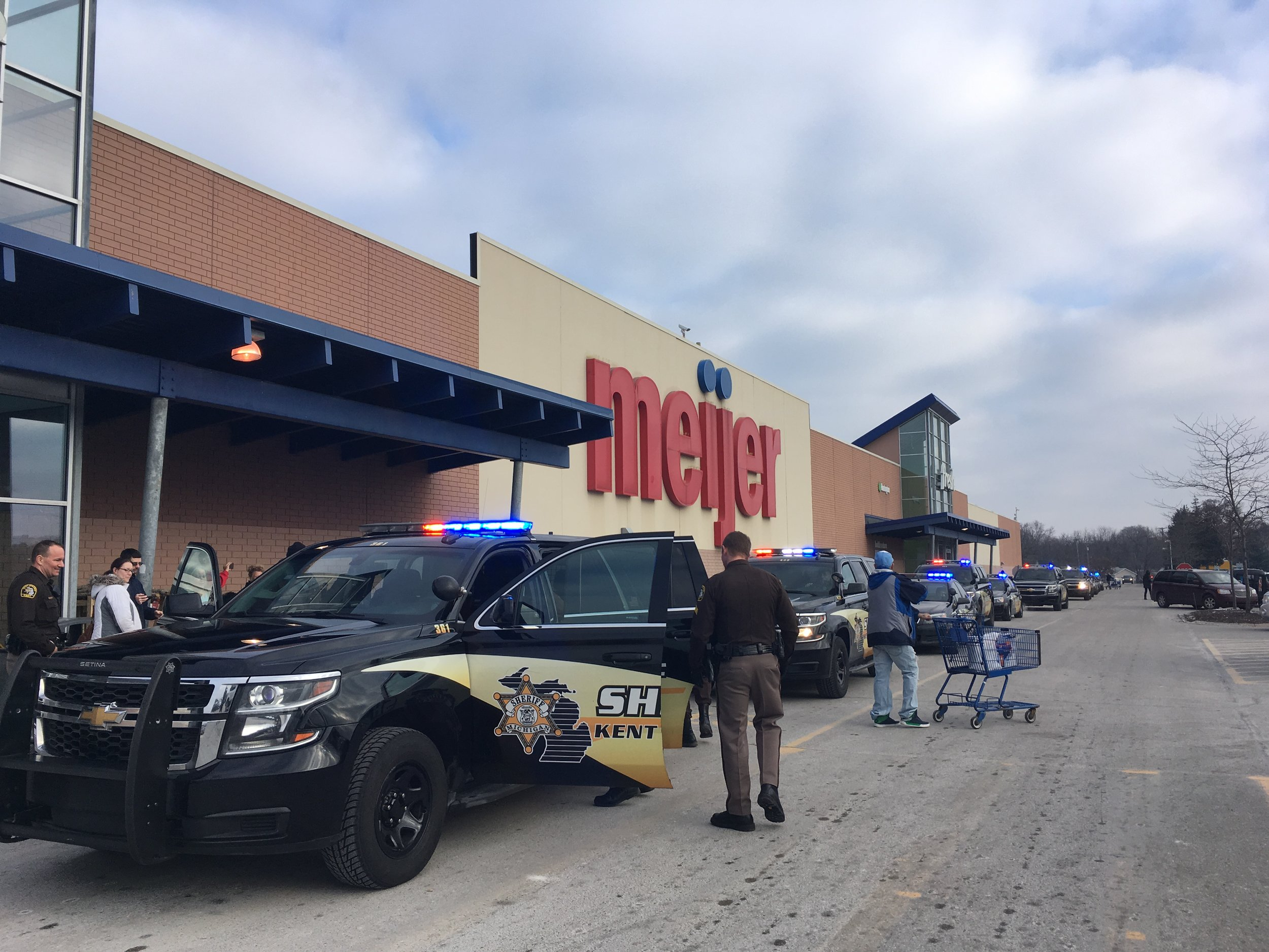 Nearly 40 children began their Christmas shopping with Sheriff deputies with a ride around the parking.
