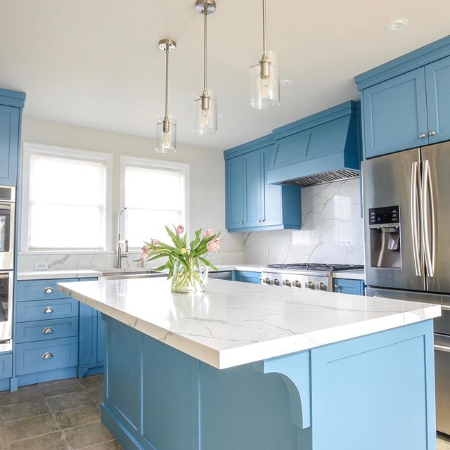 Here's a little something to brighten up this cloudy day. The whipple blue paint colour makes this century home kitchen bright and fun, while still remaining sophisticated and elegant . We really wanted to modernize this space. However, it was important to maintain the charm and character that can be found throughout the rest of this century home. By adding shaker detail throughout, corbel details on the island, furniture kick on the sink cabinet and open wine storage we were well on our way at accomplishing this. Throw in the right paint colour, suitable pulls and beautiful quartz counter top our mission was complete. #batteauxcreekkitchens #customkitchen #kitchendesign #kitchenreno #whippleblue #corbel #cuppulls #winestorage #pendantlights #centuryhome