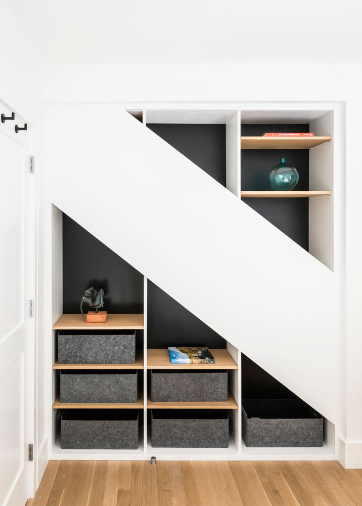- We wanted to gain some space and put a closet in this bedroom, so we decided to remove the cabinet in the wall. When we opened up the wall and found this structural steel beam, we immediately saw the space above and below it as a chance to get creative. Rather than close the wall back up, we decided to turn the space around the beam into these triangle cabinets to give an interesting storage option.