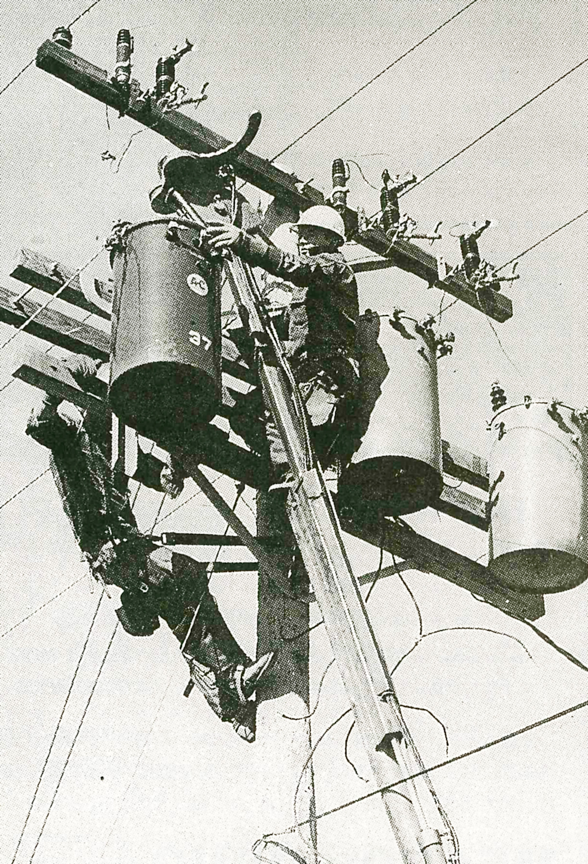 old photo of workers on power line