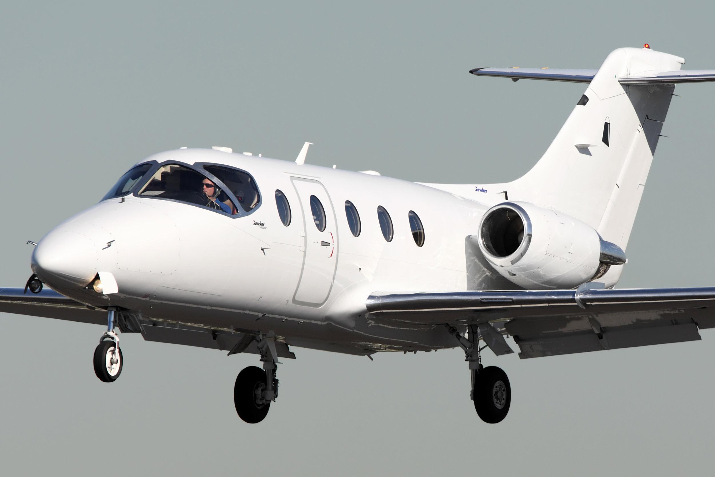 Hawker-400XP_landing_Light-jet_Legacy_Aviation_Private_Jet_NetJets_Jet_Charter_TEB_VNY_MIA_PBI_FRG_SFO_FLL_FXE_BED.jpg