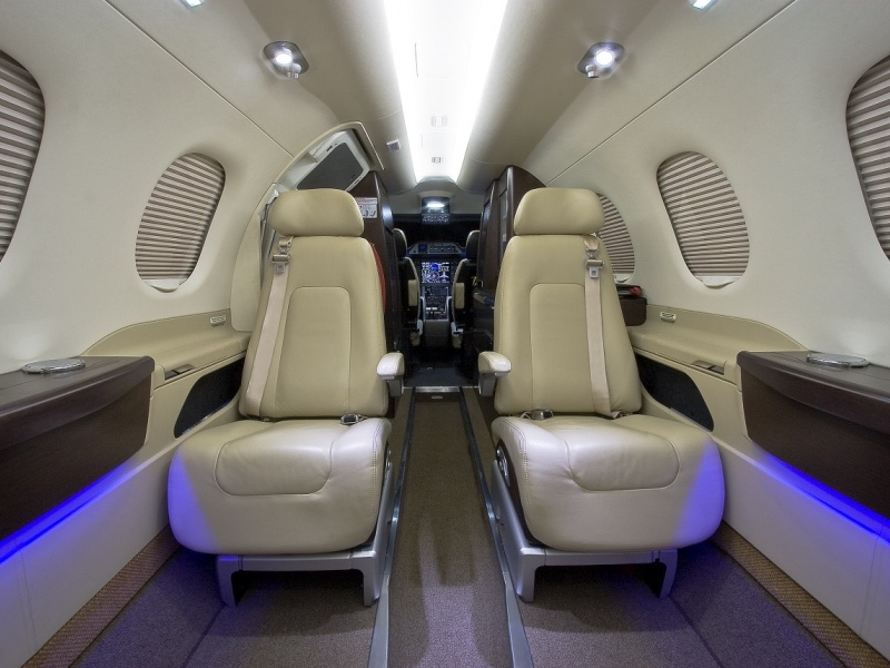 Phenom-300_Light-Jet_Interior-2_Legacy_Aviation_Private_Jet_NetJets_Jet_Charter_TEB_VNY_MIA_PBI_FRG_SFO_FLL_FXE_BED.jpg