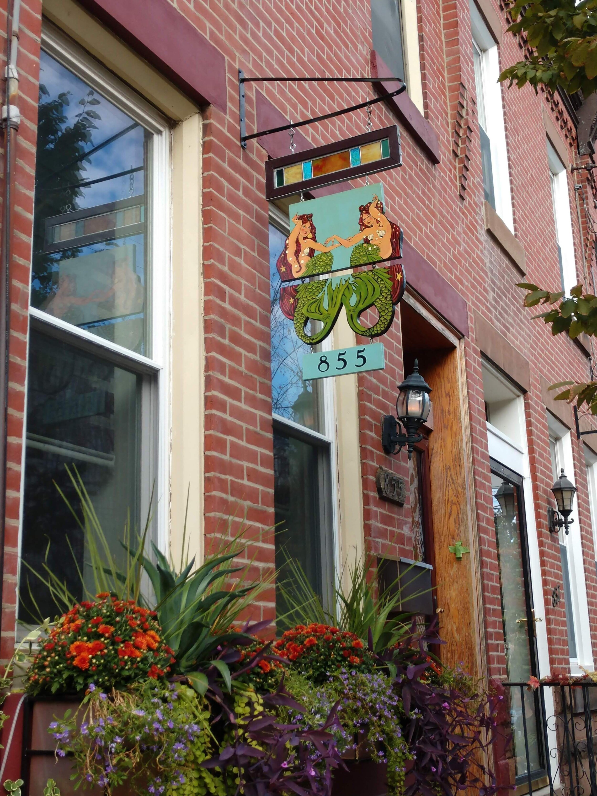 These mermaids are lucky to live above these beautiful window boxes!