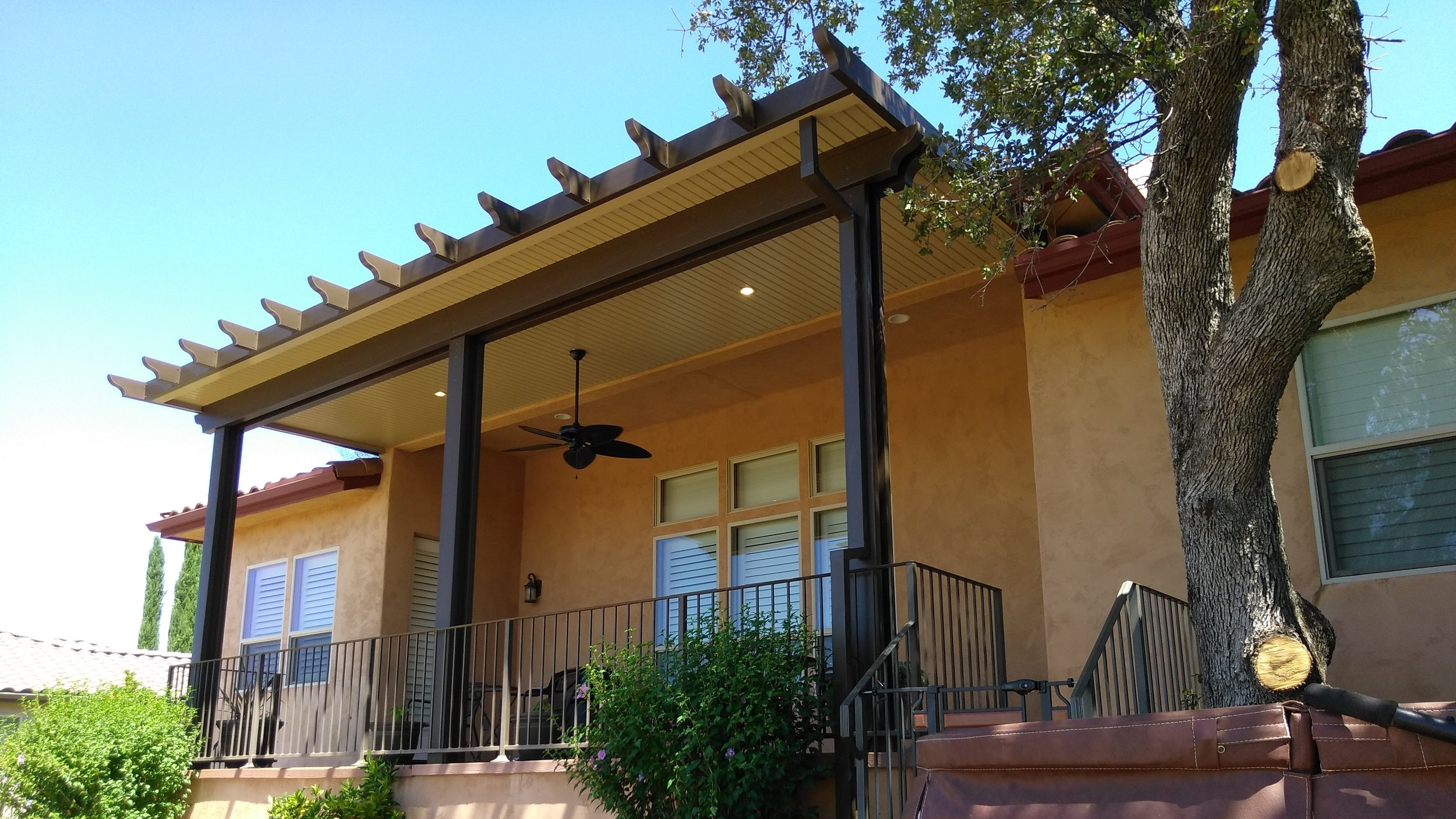 - With our aluminum shade structures, you get the best of both worlds: the beauty of wood and the convenience of a highly durable, low-maintenance aluminum surface. Unlike wood, these shade structures won't crack, peel, warp, or rot. They're also termite-proof, don't burn, and never need painting. Whether you're attaching a shaded area to your home, or building a freestanding private retreat, our patio covers have the design flexibility needed to make your vision a reality.