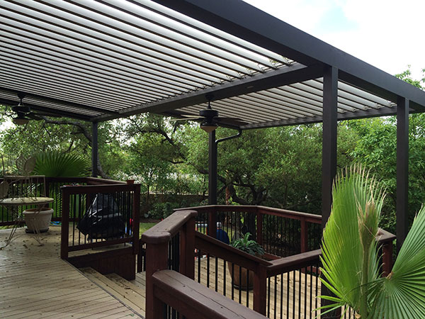 - Our Louvered Patio Cover is manufactured with quality elements, precision engineering, and aesthetic options to fulfill your dreams of the ultimate outdoor space. Our patio system is strong and conforms to nearly all wind and snow load requirements. The louvers are neutrally versatile to integrate flawlessly into any architectural style, such as gable roofs, bay windows, doors, or angled roofs and walls. With a touch of the remote button, louvers can be repositioned for the exact amount of protection or ventilation desired. The solar-powered battery pack eliminates the environmental impact and expense since no additional energy is required.