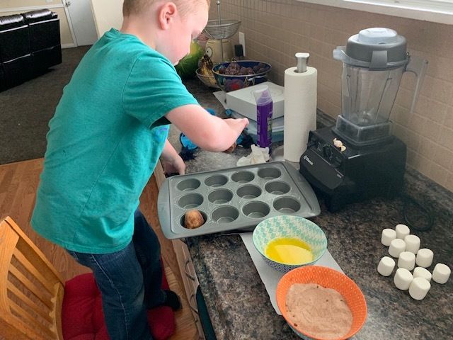 His favorite part. He loves plopping the roll dough into the muffin tin. Makes me laugh every time. FYI, you can use any type of pan you'd like. Muffin tins seem to work well with us.