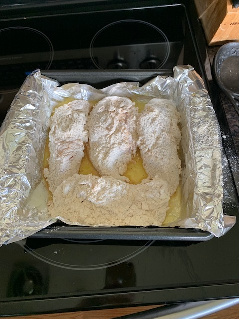 Place the chicken in the melted butter dish and USE OVEN MITTS! The dish will still be hot!!! (I learned the hard way) and place it in the oven for 35 minutes. If you're using tenderloins, cook 25 min or until cooked through.