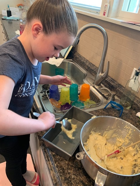 Add your batter to the bread pan. (This part takes forever but I don't mind. Hannah's very meticulous and a perfectionist. I have no idea where she gets it from ;) ).