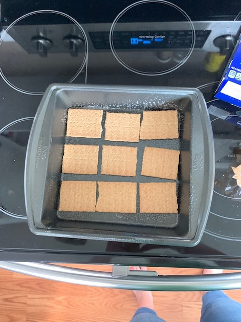 1. Preheat your oven to 350 and spray a 9x13 pan or an 8x8 pan if you want a smaller batch with cooking spray. Layer your graham crackers on the bottom of the pan.