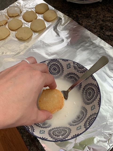 Dip the top of your cooled cookies into the icing and then place them back on your rack or foil to set.