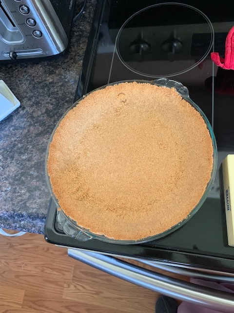 What your crust will look like after you pre-bake it. sorta the same, but it's set so it wont crumble once you put your filling in! Let cool while you make your filling.