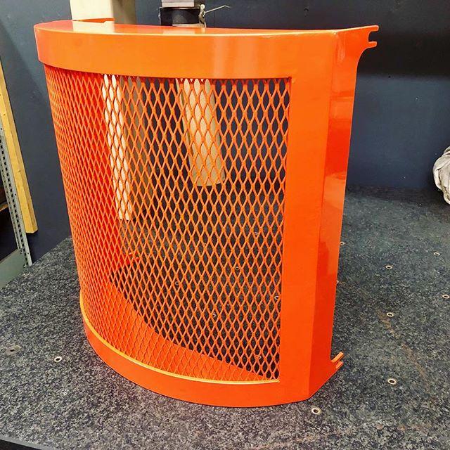 Orange powder coated shroud.  #machineshop #metal #industrial #metalfabrication #canada