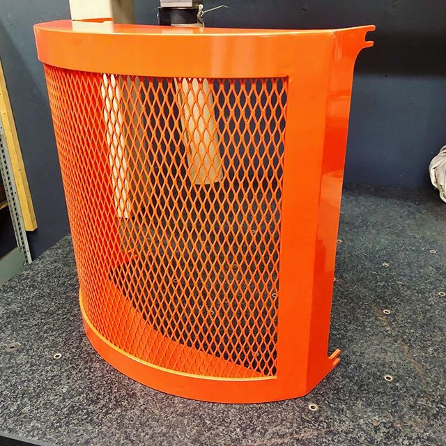 Orange powder coated shroud.  #machineshop #metal #industrial #metalfabrication #canada