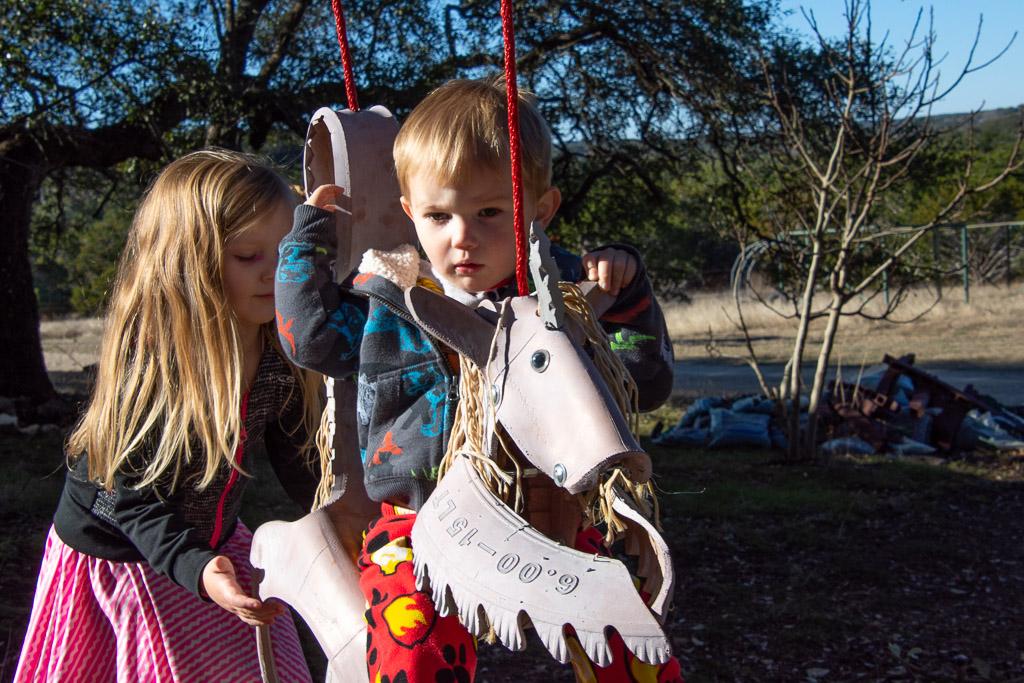 grandkids_on_unicorn_swing.jpg