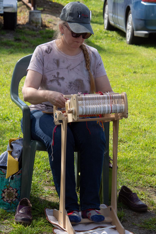 Demonstrating on a rigid heddle loom.