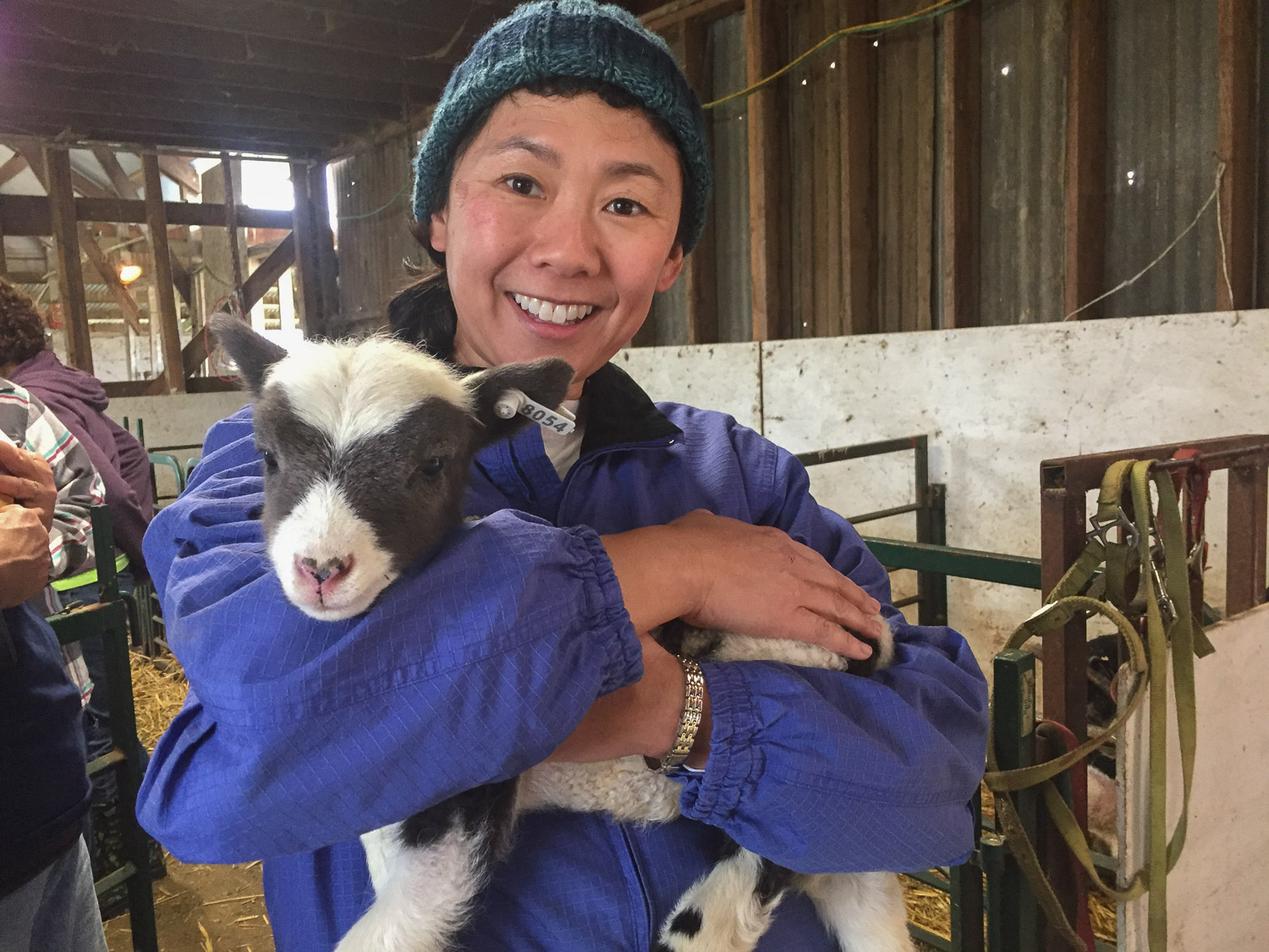 Sumi holding a Jacob lamb named Zorra.
