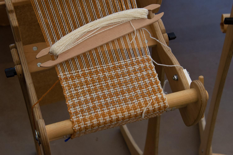 Rigid heddle loom warped with wool.