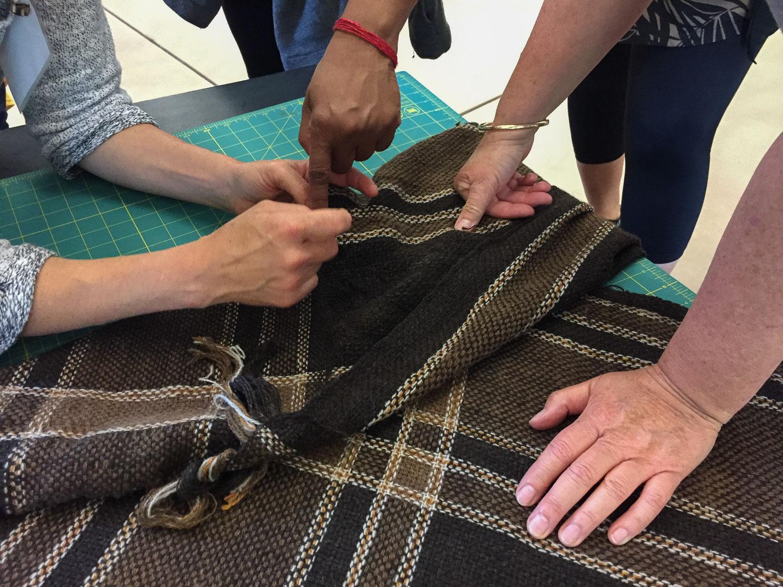 Finishing handwoven v-shawl.