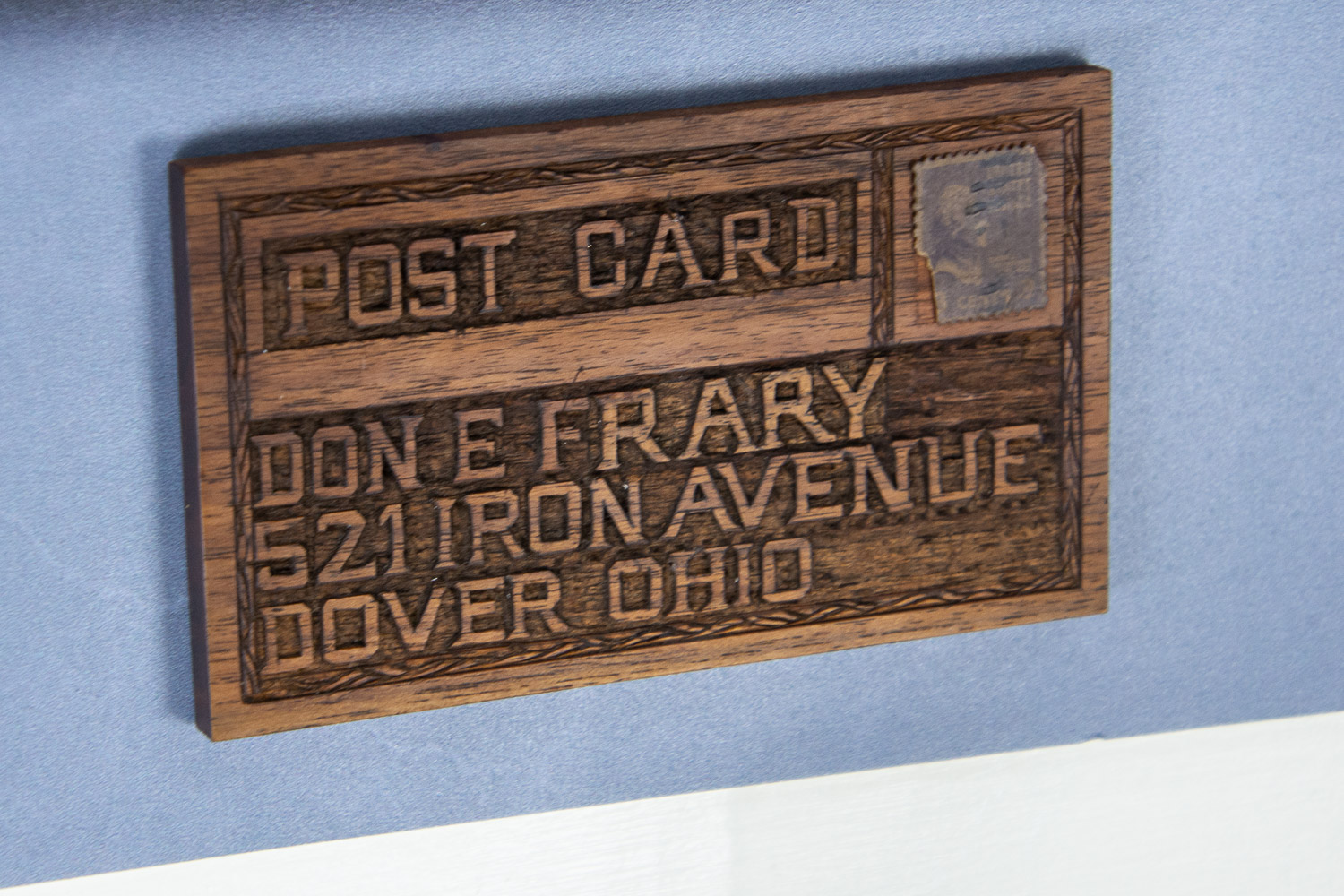 Wooden postcard at Ernest Warther Museum in Dover, Ohio.