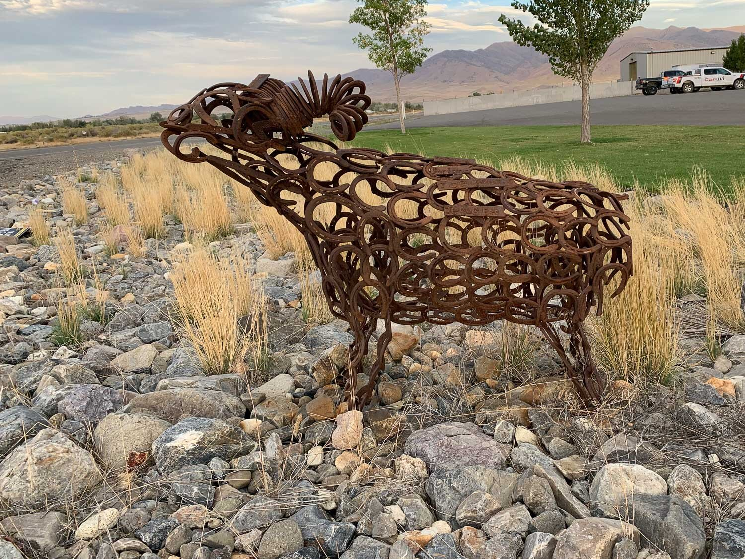sheep sculpture made of horseshoes.