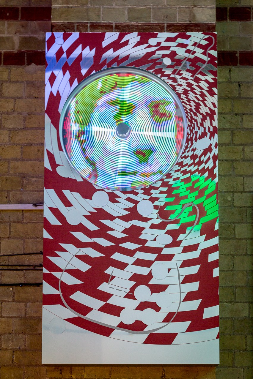 CODA, 2016 aluminium casing housing spinning bicycle wheel  LED projection of animation based  Permanent art work for Cambridge Corn Exchange celebrating Syd Barrett founder of Pink Floyd.