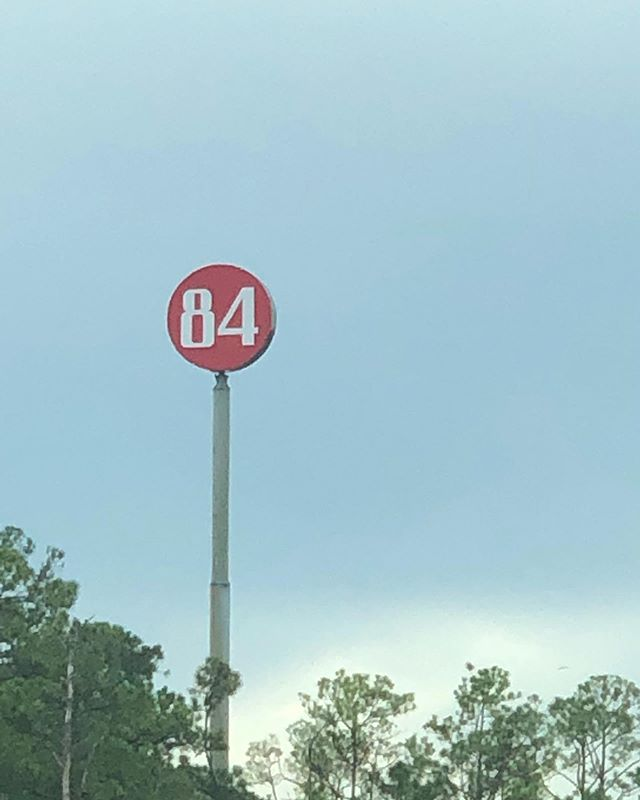 """""""EIGHTY FOUR. NO MORE. NO LESS. Put it on a stick and thrust it into the sky so everyone driving on the interstate can see it"""" -?? — . . . . . #signage #signs #eightyfour #numbers"""