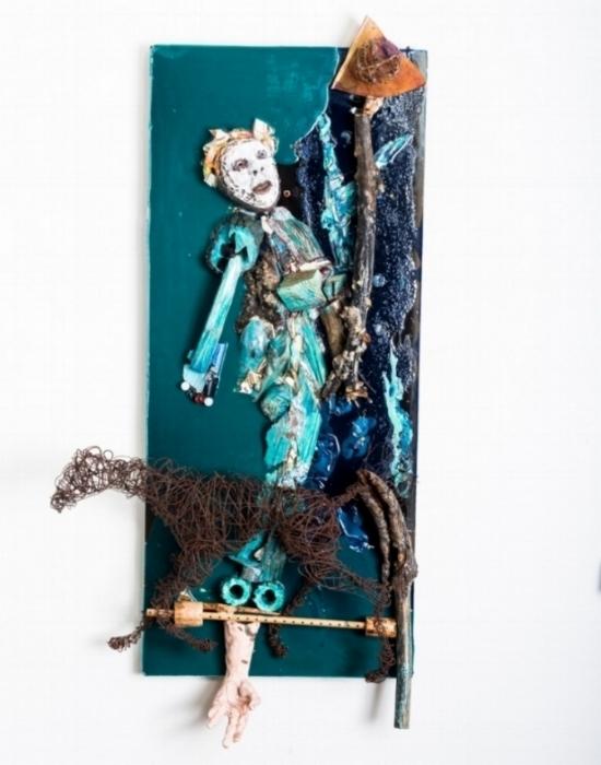 "Trickster Rides Again  Mask in Situ 2018, epoxy, ceramic, glass, aluminum, steel, copper, wood, sand, acrylic, 47x24x8"""