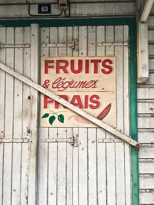 Do they speak English in Guadeloupe? Unfortunately, Guadeloupe is a French Caribbean island. THe main language is French, but they do speak English.  Here on this photo, you can see a sign for fruits and veggies.